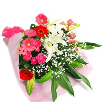 白ユリをメインにピンク系のお花を添えた花束